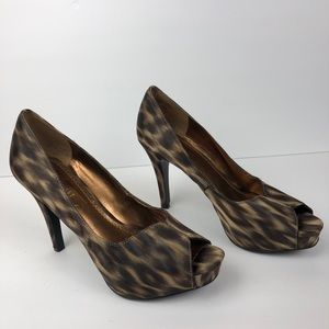 "Nine West | 4"" Platform Cheetah High Heels"
